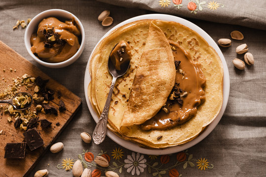 Thin Crepes with Butterscotch and almonds and chopped chocolate. Top view