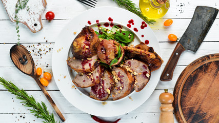 Stuffed duck with cranberry sauce. Restaurant dishes. Top view. Free copy space.