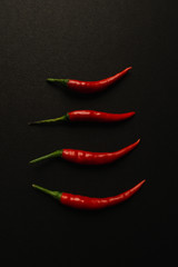Canvas Prints Hot chili peppers red hot chili pepper on black background