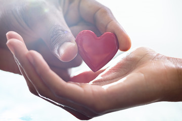 Male Hand Giving Heart To Female