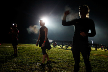"Participants take part in an extreme night run ""Bison race"" near the town of Logoisk"