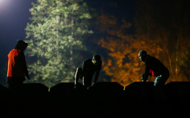 "Participant takes part in an extreme night run ""Bison race"" near the town of Logoisk"