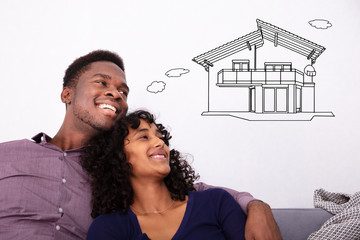 Happy Couple Dreaming About The Future Home
