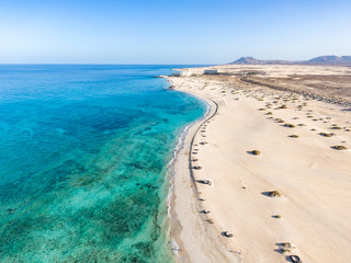 Panoramic high angle aerial drone view of Corralejo National Park (Parque Natural de Corralejo) with sand dunes located in the northeast corner of the island of Fuerteventura, Canary Islands, Spain.