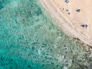 Panoramic bird's eye aerial drone view of a beach section at Corralejo National Park (Parque Natural de Corralejo) in the northeast corner of the island of Fuerteventura, Canary Islands, Spain.