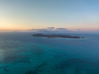 Stunning high angle panoramic aerial drone view of Isla de Lobos, a small uninhabited island just 2 kilometres off the coast of Fuerteventura, Canary Islands, Spain. Lanzarote in the background.