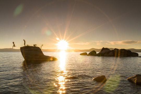 People jumping off Bonsai Rock in Lake Tahoe, California
