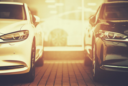luxury business cars in golden colors on car dealership parking