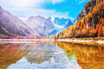 Beautiful seasonal Aurumnal scenery of mountain lake in Dolomite Alps in Italy. Beautiful Alpine landscape. Autumn in Alps.