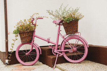 Photo sur Toile Velo upcycled recycled pink old vintage shabby bycicle used as a flower pot