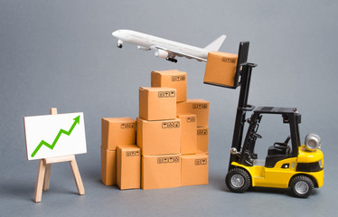 Cargo airplane, forklift truck with cardboard boxes and green arrow up. Increase freight transportation and delivery volumes of products goods. orders growth and throughput of transport infrastructure Fototapete