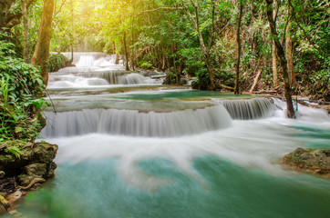 Foto op Aluminium Bos rivier Travel to the beautiful waterfall in tropical rain forest, soft water of the stream in the natural park at Huai Mae Khamin Waterfall in Kanchanaburi, Thailand.