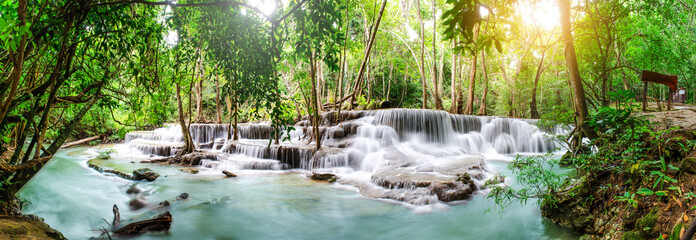 Fototapeten Wasserfalle Travel to the beautiful waterfall in tropical rain forest, soft water of the stream in the natural park at Huai Mae Khamin Waterfall in Kanchanaburi, Thailand.