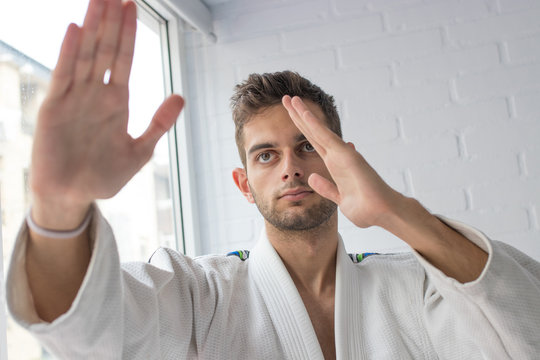 portrait of young man practicing martial arts