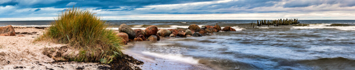 Panorama. Remains of old abandoned pier, Baltic Sea