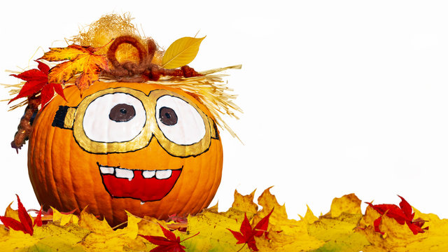 Laughing pumpkin face painted on white background