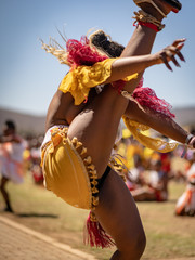 Dancing Zulu woman wear traditional cloth, South Africa