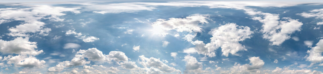 Fototapeta Seamless cloudy blue sky hdri panorama 360 degrees angle view with zenith and beautiful clouds for use in 3d graphics as sky dome or edit drone shot