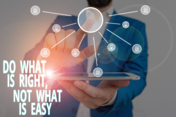 Word writing text Do What Is Right Not What Is Easy. Business photo showcasing Make correct actions Have integrity Male human wear formal work suit presenting presentation using smart device