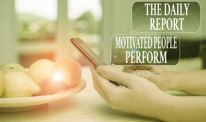 Text sign showing The Daily Report Motivated People Perform. Business photo text assignment created to rate workers woman using smartphone office supplies technological devices inside home