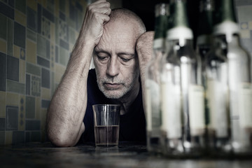 A desperate man falls into depression and becomes alcoholic and miserable. His addiction leads him to a state of loneliness and poverty. He has no hope and could be suicidal.