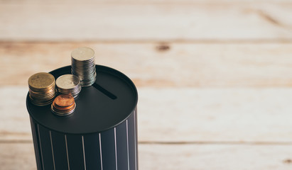 Coins stack on coin bank. Growth rate of cash deposit, salary earning, income, investment and saving money for sustainable personal future and sucess. Accounting, financial and business photo concept