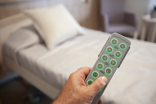 Adjustable bed remote in hand