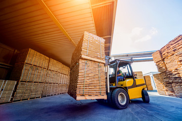 Forklift loader load lumber into a dry kiln. Wood drying in containers.
