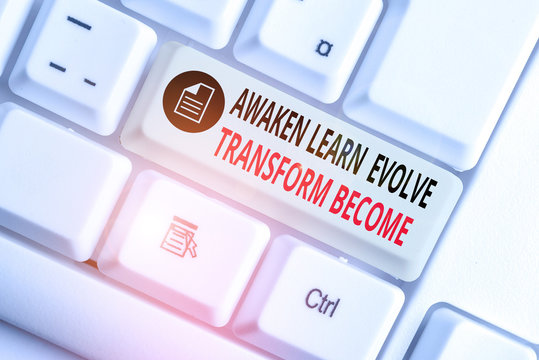 Handwriting text writing Awaken Learn Evolve Transform Become. Conceptual photo Inspiration Motivation Improve White pc keyboard with empty note paper above white background key copy space
