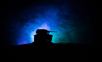 War Concept. Military silhouettes fighting scene on war fog sky background, Silhouette of armored vehicle below Cloudy Skyline At night. Attack scene. Tanks battle.