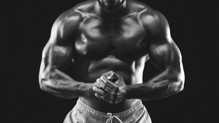 Black and white photo of male muscular body