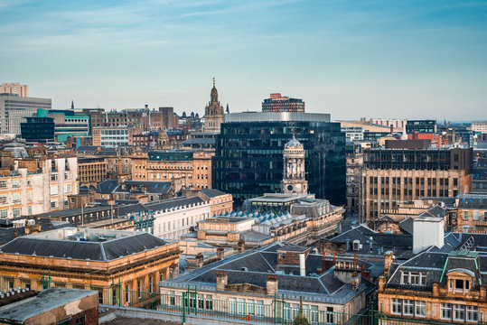 A rooftop view of the mixed architecture of old and new buildings in Glasgow city in late afternoon light, Scotland