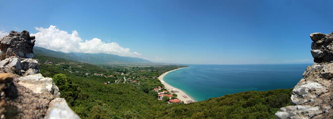Far view at greece coastline with beautiful blue sky