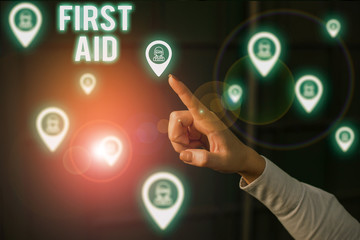 Word writing text First Aid. Business photo showcasing Practise of healing small cuts that no need for medical training Woman wear formal work suit presenting presentation using smart device