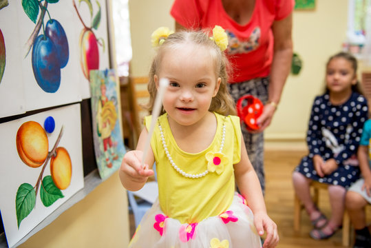 Girl with Down Syndrome develops thinking in a rehabilitation center for special children