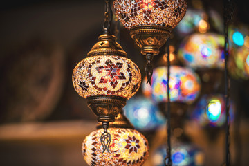 Oriental lamps in brass with colorful glasses during evening. Very popular lamps in the middle east.