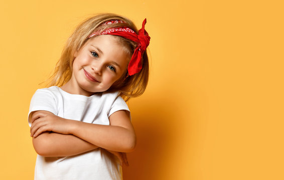 Little baby girl in white blank white t-shirt design red head band happy smiling on yellow