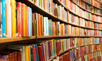 Library with many shelves and books, diminishing perspective and shallow dof