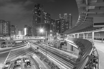 Fototapete - Traffic and skyline of downtown of Hong Kong city at night