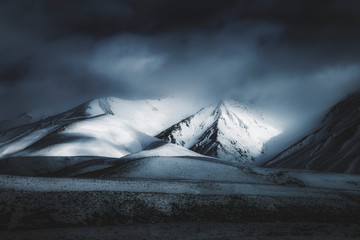 Papiers peints Gris traffic mountains in winter, dark fantasy moody dramatic mountain landscape photograph background
