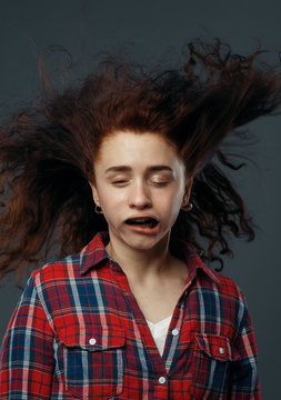 Strong wind blowing on woman's face, funny emotion