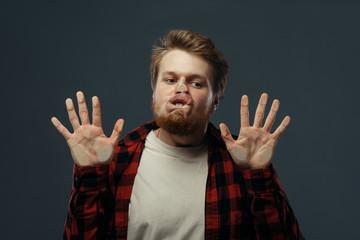 Fototapeta Man's crazy face crushed on transparent glass obraz