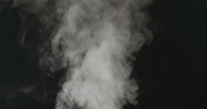 water mist over black background