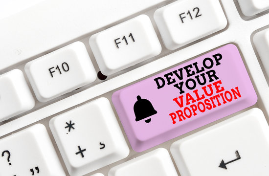 Writing note showing Develop Your Value Proposition. Business concept for Prepare marketing strategy sales pitch White pc keyboard with note paper above the white background