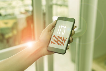 Handwriting text writing It S Sunday. Conceptual photo Day of rest and religious worship Part of the weekend woman using smartphone office supplies technological devices inside home