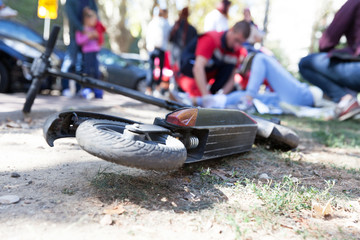 Obraz First aid for electric scooter rider injured in an accident - fototapety do salonu