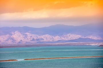 Fototapete - Dead Sea salty shore. Beautiful nature. Tropical landscape. Summertime. The Dead Sea against mountains at sunset