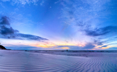 Baltic Sea and beautiful sunset on the beach in Slowinski National Park near Leba, Poland. Wild,...