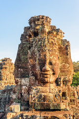 Fototapete - Beautiful view of towers with stone faces of Bayon temple