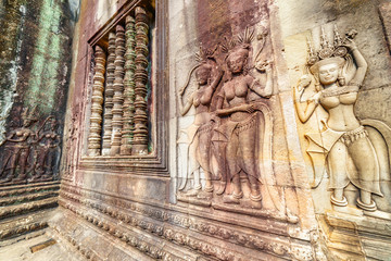 Wall Mural - Awesome bas-reliefs at ancient temple complex Angkor Wat